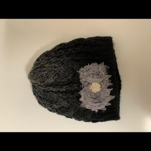black beenie with flower and rhinestones